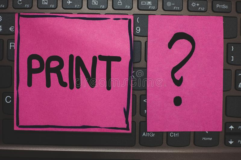 Writing note showing Print. Business photo showcasing Produce letter numbers symbols on paper by machine using ink or toner Black. Laptop keyboard pink paper royalty free stock photos