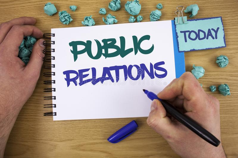 Writing note showing Public Relations. Business photo showcasing Communication Media People Information Publicity Social Text two. Words blue white notepad blue royalty free stock photography