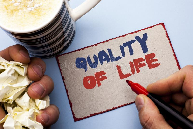 Writing note showing Quality Of Life. Business photo showcasing Good Lifestyle Happiness Enjoyable Moments Well-being written by. Man Cardboard Piece Holding stock image
