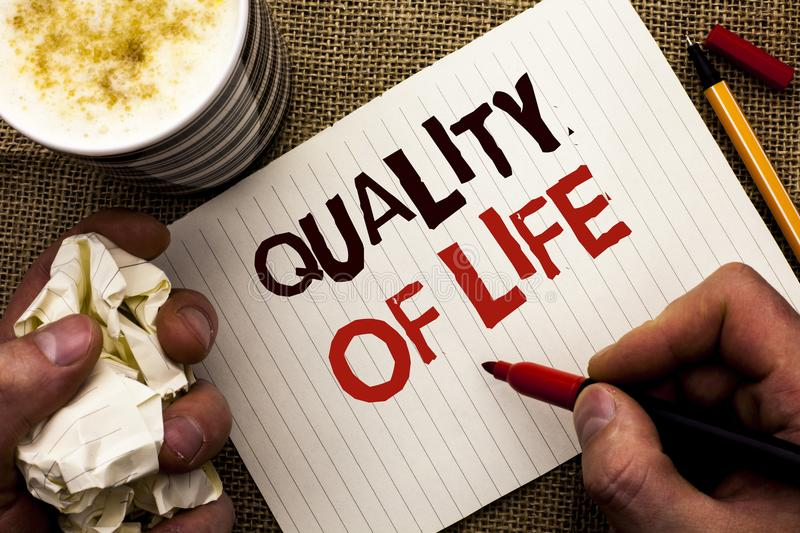 Writing note showing Quality Of Life. Business photo showcasing Good Lifestyle Happiness Enjoyable Moments Well-being written by. Man Holding Marker Notebook royalty free stock image