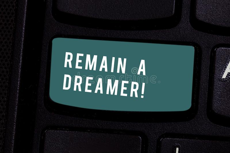 Writing note showing Remain A Dreamer. Business photo showcasing they spend lot of time thinking about and planning. Writing note showing Remain A Dreamer stock photography