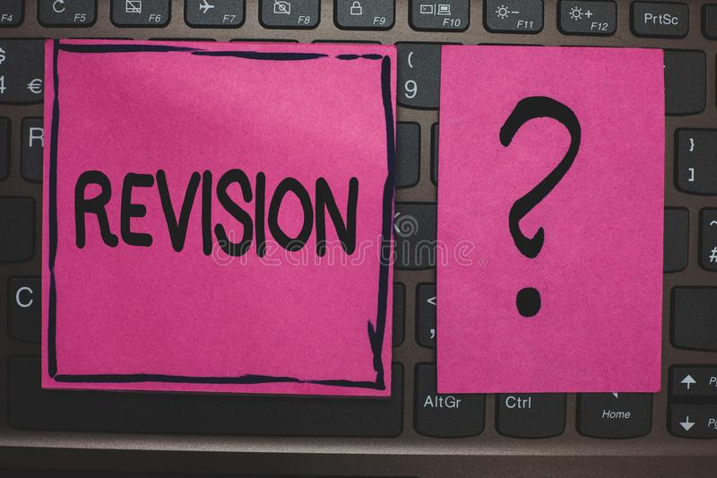 Writing note showing Revision. Business photo showcasing Rechecking Before Proceeding Self Improvement Preparation Black laptop ke. Yboard pink paper ask thought royalty free stock photography