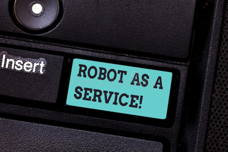 Writing note showing Robot As A Service. Business photo showcasing Artificial intelligence Digital assistance chat bot. Keyboard key Intention to create royalty free stock image