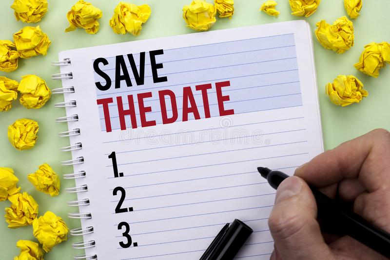 Writing note showing Save The Date. Business photo showcasing Remember not to schedule anything else that time Appointment writte royalty free stock photo
