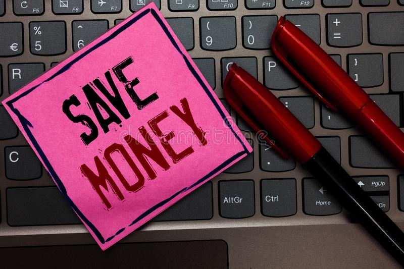 Writing note showing Save Money. Business photo showcasing store some of your cash every month to use them sometime later Pink pap. Er keyboard Inspiration stock photos