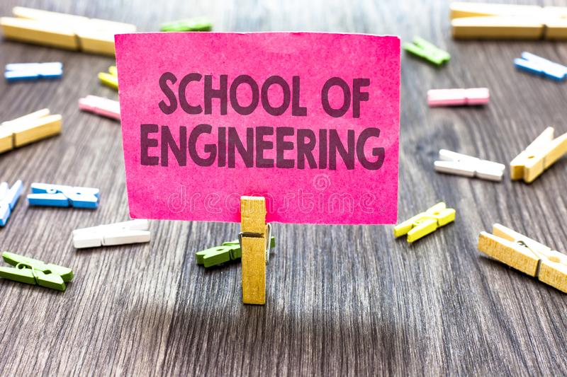 Writing note showing School Of Engineering. Business photo showcasing college to study mechanical communication subjects Multiple. Clips woody table small card royalty free stock photos