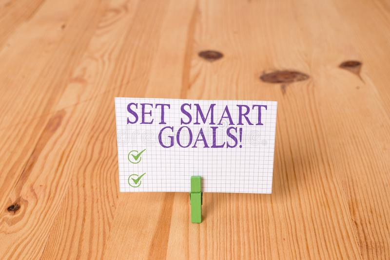 Writing note showing Set Smart Goals. Business photo showcasing list to clarify your ideas focus efforts use time wisely. Writing note showing Set Smart Goals royalty free stock photography