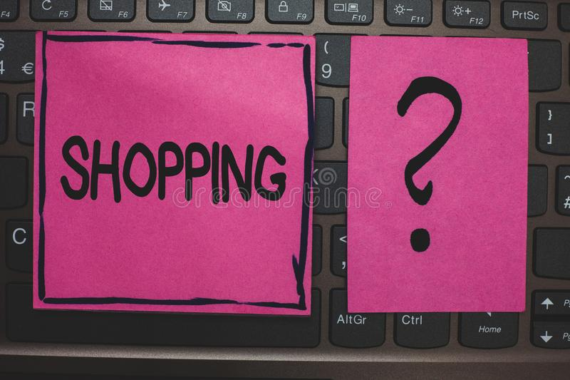 Writing note showing Shopping. Business photo showcasing Shopper customer purchase goods products store experience Black laptop ke. Yboard pink paper ask thought royalty free stock photo