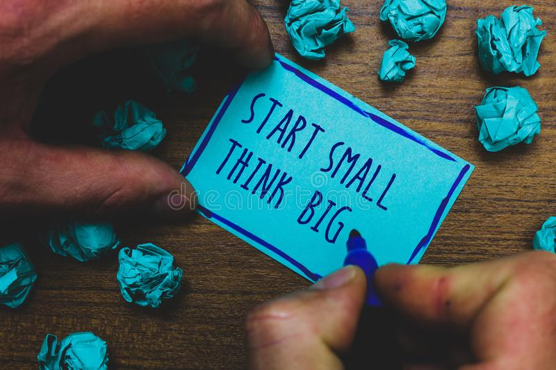 Writing note showing Start Small Think Big. Business photo showcasing Initiate with few things have something great in mind Foggy. Hand hold marker drawn blue stock photography