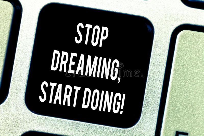 Writing note showing Stop Dreaming Start Doing. Business photo showcasing Put your dreams into action Materialize it. Keyboard key Intention to create computer stock image
