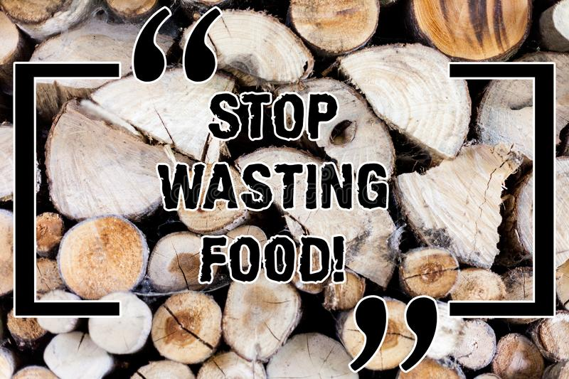 Writing note showing Stop Wasting Food. Business photo showcasing organization works for reduction food waste in society. Wooden background vintage wood wild royalty free stock image