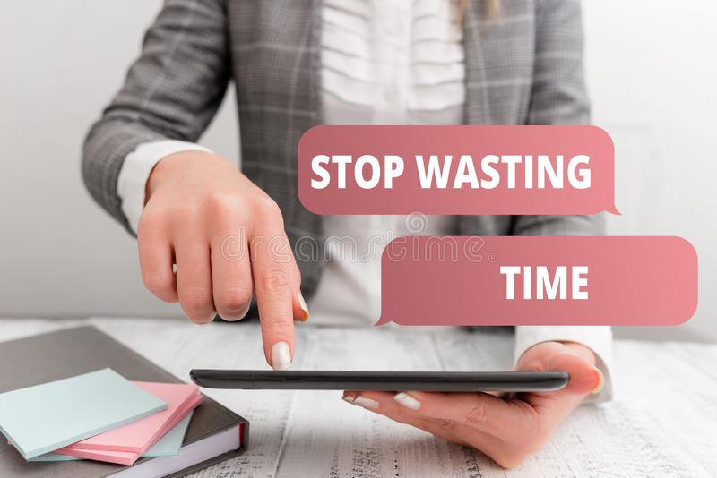 Writing note showing Stop Wasting Time. Business photo showcasing advising demonstrating or group start planning and use. Writing note showing Stop Wasting Time stock photography