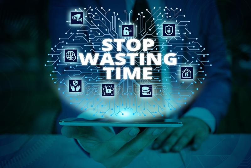 Writing note showing Stop Wasting Time. Business photo showcasing advising demonstrating or group start planning and use. Writing note showing Stop Wasting Time royalty free stock images