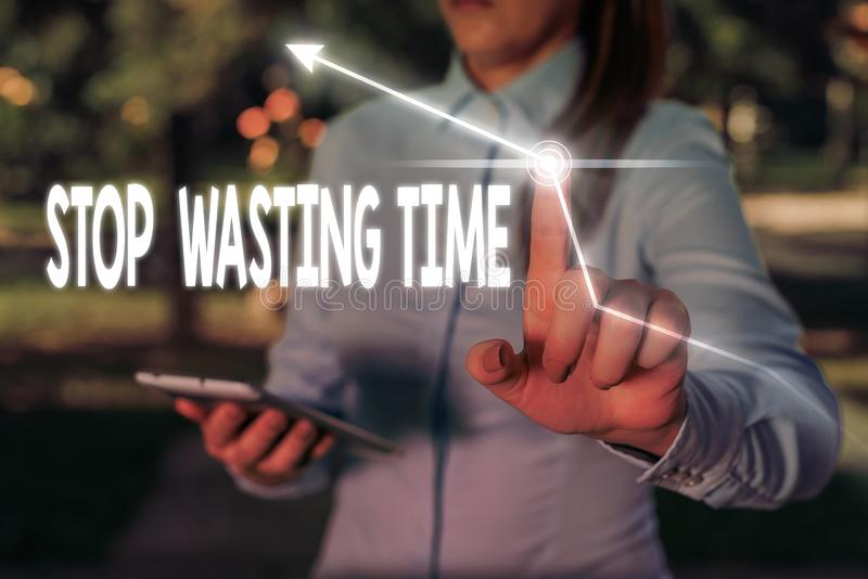 Writing note showing Stop Wasting Time. Business photo showcasing advising demonstrating or group start planning and use. Writing note showing Stop Wasting Time royalty free stock photography