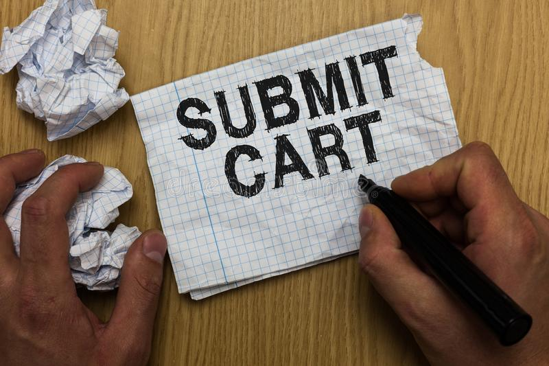 Writing note showing Submit Cart. Business photo showcasing Sending shopping list of online items Proceed checkout Man holding mar. Ker notebook paper crumpled royalty free stock photos