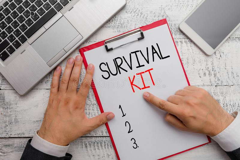 Writing note showing Survival Kit. Business photo showcasing Emergency Equipment Collection of items to help someone. Writing note showing Survival Kit stock images