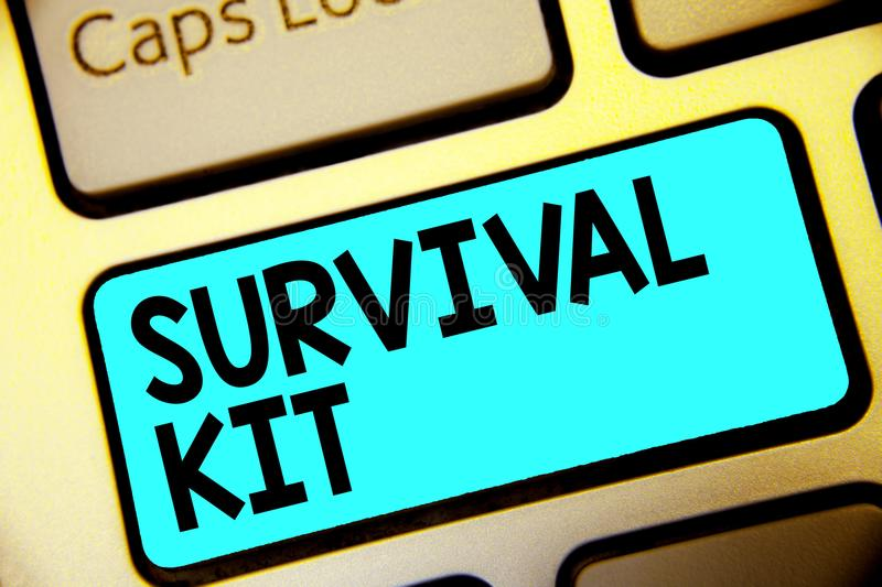 Writing note showing Survival Kit. Business photo showcasing Emergency Equipment Collection of items to help someone Keyboard blue. Key Intention computer stock images
