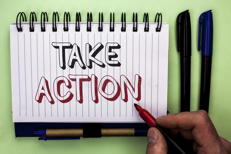 Writing note showing Take Action. Business photo showcasing Strategy Future Actions Procedure Activity Goal Objective written by. Man Holding Marker Nootbook stock photos