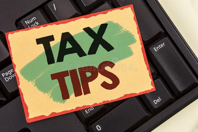 Writing note showing Tax Tips. Business photo showcasing Help Ideas for taxation Increasing Earnings Reduction on expenses Concept. Writing note showing Tax Tips royalty free stock photography