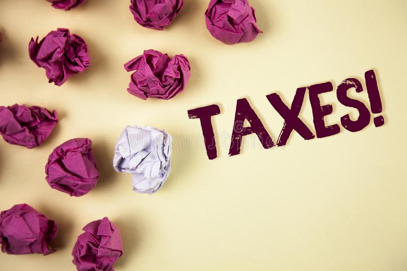 Writing note showing Taxes Motivational Call. Business photo showcasing Money demanded by a government for its support written on. Writing note showing Taxes royalty free stock photography