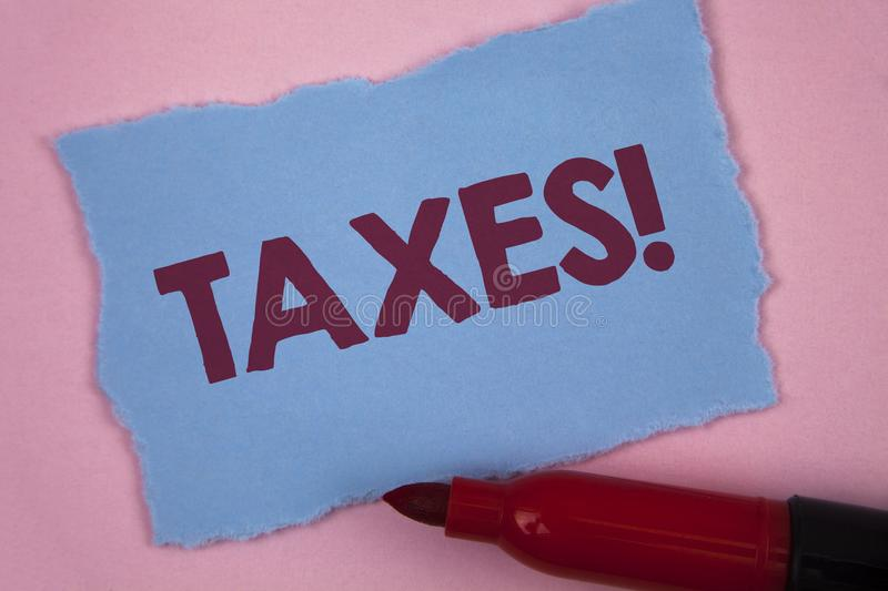 Writing note showing Taxes Motivational Call. Business photo showcasing Money demanded by a government for its support written on. Writing note showing Taxes royalty free stock photos