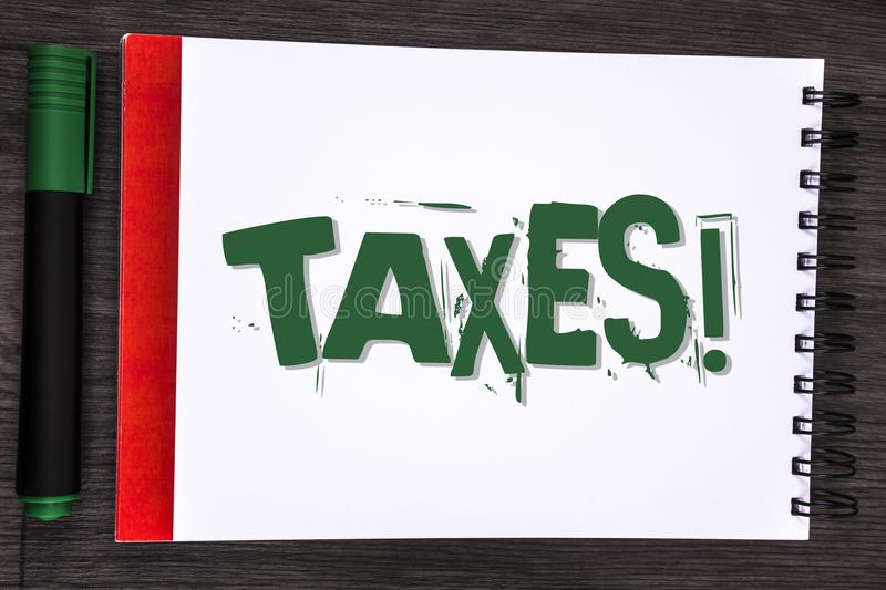 Writing note showing Taxes Motivational Call. Business photo showcasing Money demanded by a government for its support written on. Writing note showing Taxes stock photos