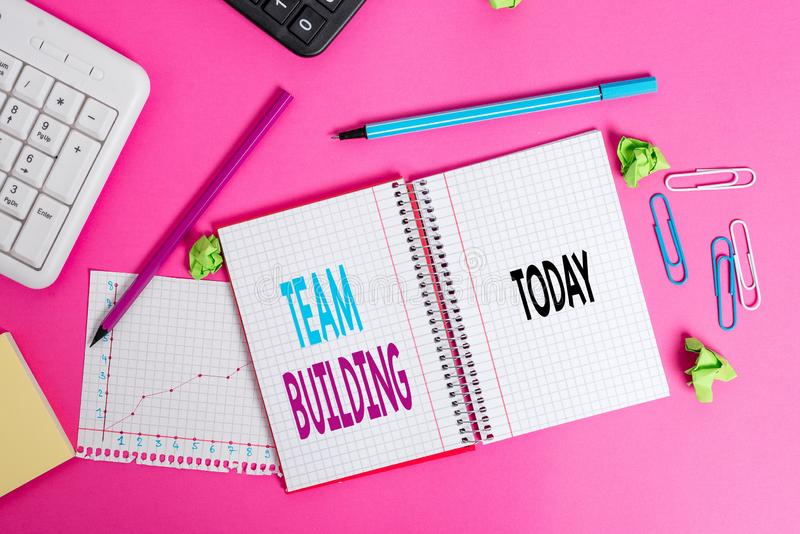 Writing note showing Team Building. Business photo showcasing various types of activities used to enhance social. Writing note showing Team Building. Business stock photos