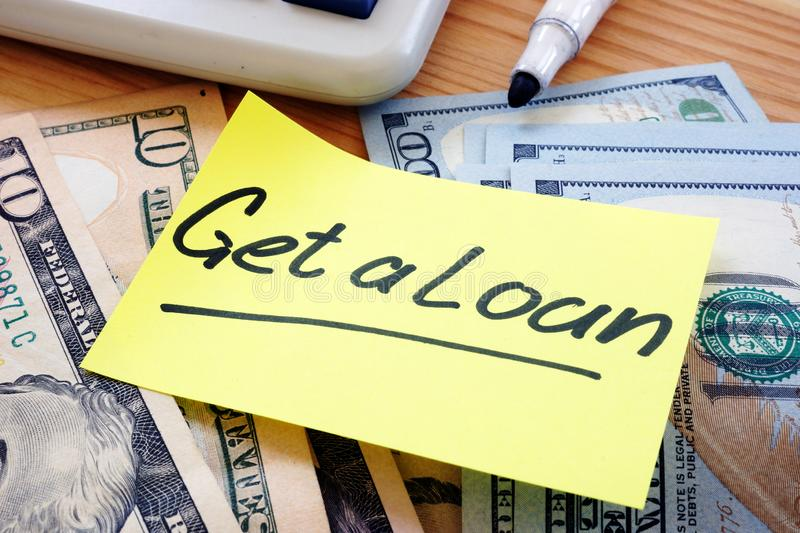 Writing note showing the text get a loan stock images