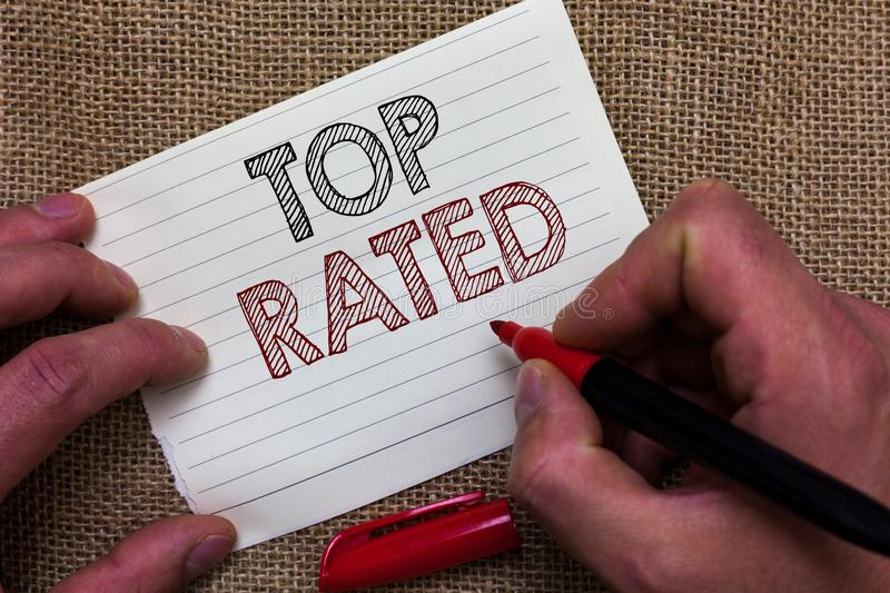 Writing note showing Top Rated. Business photo showcasing The high amount of a charge or payment based on calculation Man's hand royalty free stock photos