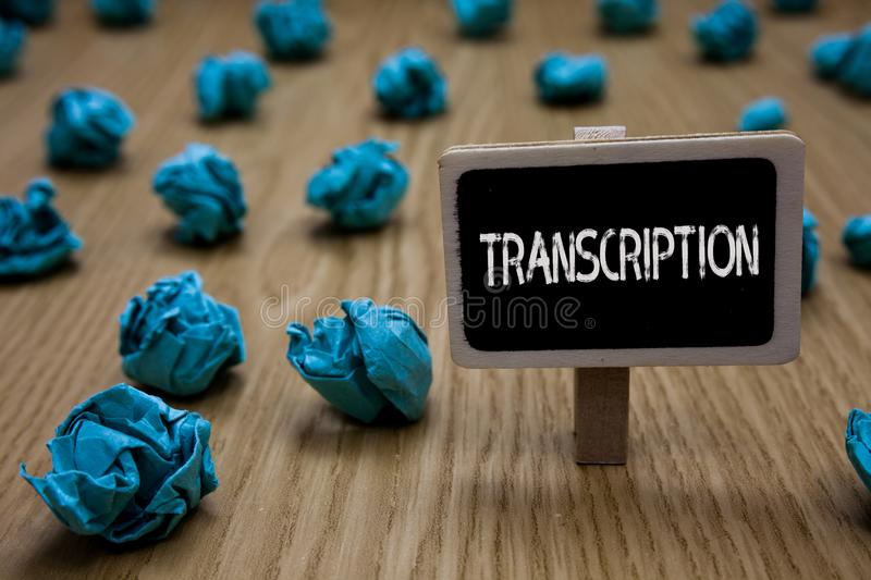 Writing note showing Transcription. Business photo showcasing Written or printed process of transcribing words text voice Cyan pap. Er imagination idea crumpled stock image