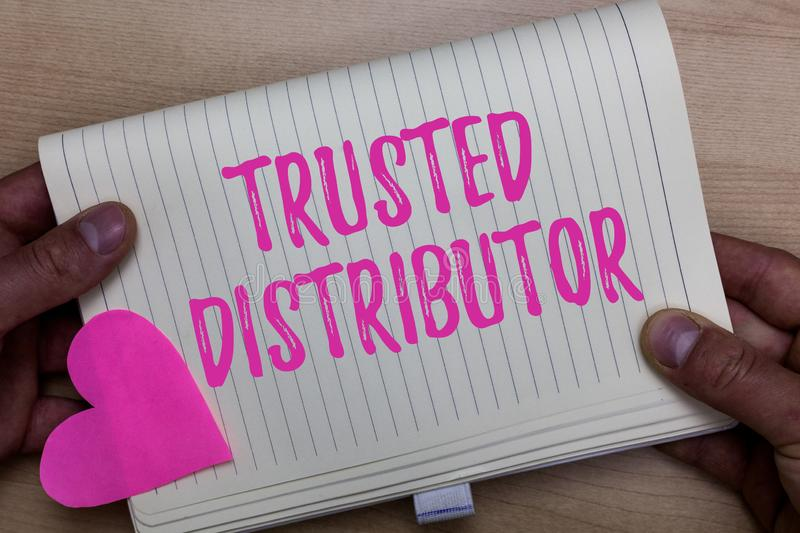 Writing note showing Trusted Distributor. Business photo showcasing Authorized Supplier Credible Wholesale. Representative Man holding notebook paper heart royalty free stock image