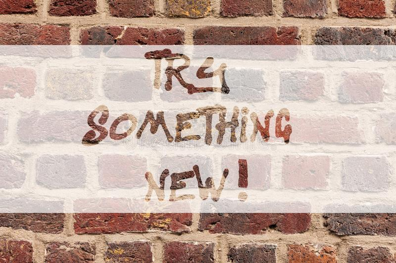 Writing note showing Try Something New. Business photo showcasing start doing anything you did not made or know before. Brick Wall art like Graffiti stock images
