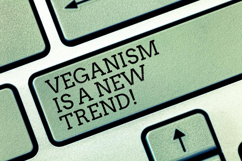 Writing note showing Veganism Is A New Trend. Business photo showcasing Healthy food vegan lifestyle fresh dishes diet. Keyboard key Intention to create royalty free stock photos