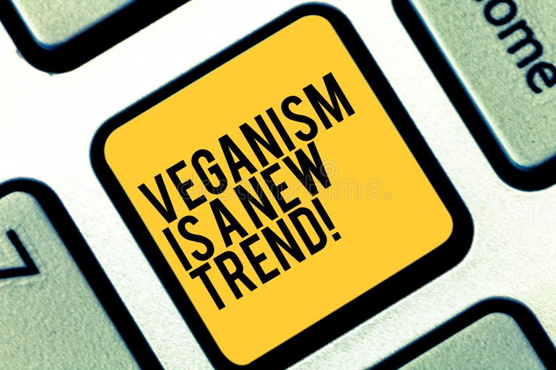 Writing note showing Veganism Is A New Trend. Business photo showcasing Healthy food vegan lifestyle fresh dishes diet. Keyboard key Intention to create stock images