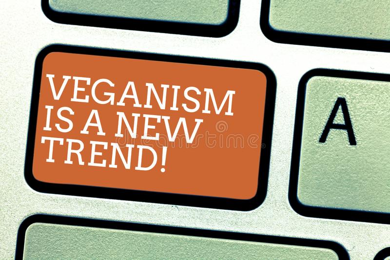 Writing note showing Veganism Is A New Trend. Business photo showcasing Healthy food vegan lifestyle fresh dishes diet. Keyboard key Intention to create stock image