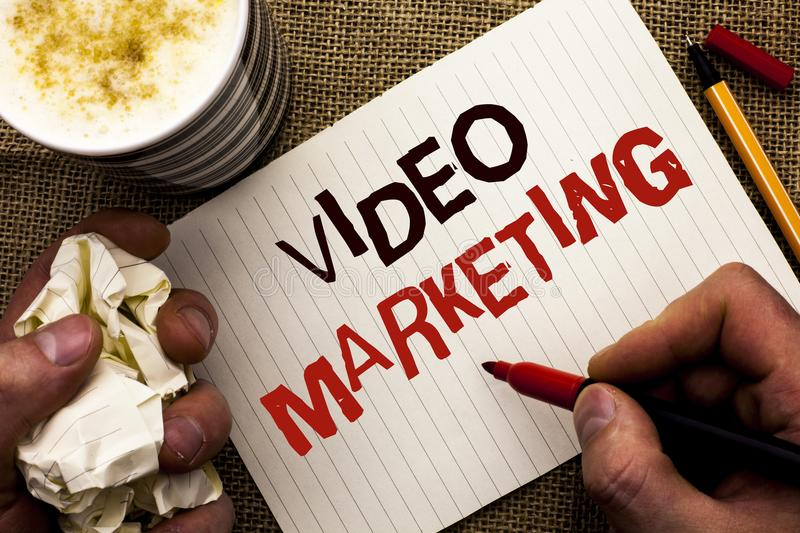 Writing note showing Video Marketing. Business photo showcasing Media Advertising Multimedia Promotion Digital Strategy written b. Y Man Holding Marker Notebook royalty free stock image