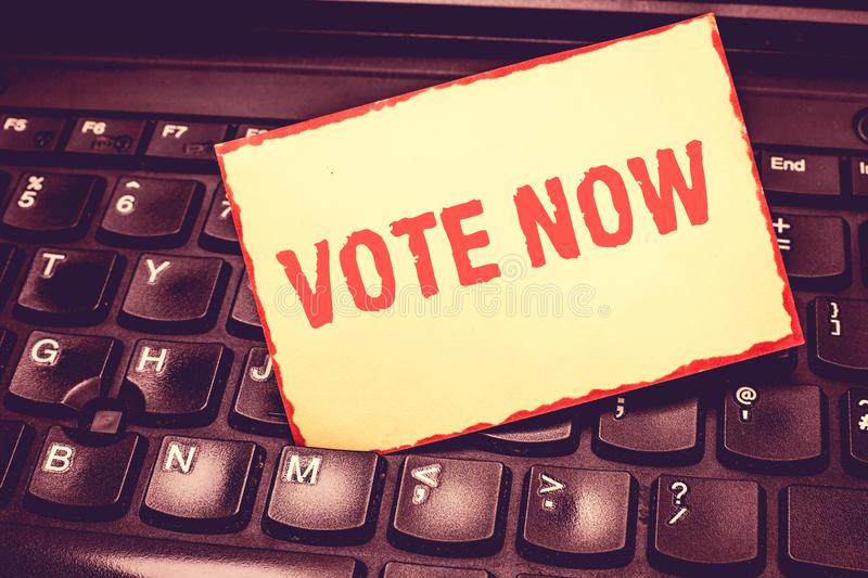 Writing note showing Vote Now. Business photo showcasing formal indication of choice between two or more courses of royalty free stock photo
