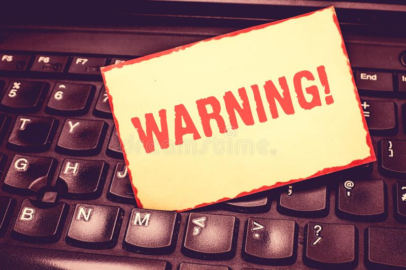 Writing note showing Warning. Business photo showcasing statement or event that warns of something or serves as example. Blank Bordered Notepad Reminding royalty free stock images