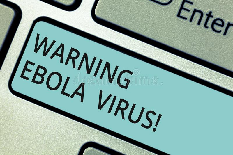 Writing note showing Warning Ebola Virus. Business photo showcasing inform showing demonstrating about this deadly. Disease Keyboard key Intention to create royalty free stock photos