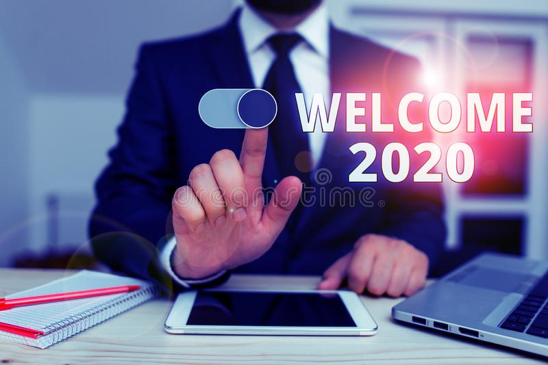 Writing note showing Welcome 2020. Business photo showcasing New Year Celebration Motivation to Start Cheers stock images