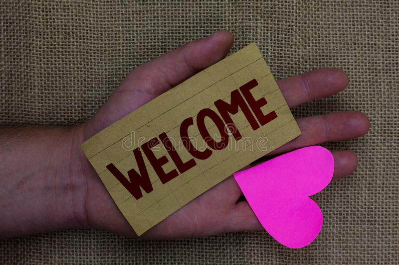 Writing note showing Welcome. Business photo showcasing Warm salutation acknowledgement for someone amiable loved thanked Wood art. Work memories lovely love royalty free stock photo
