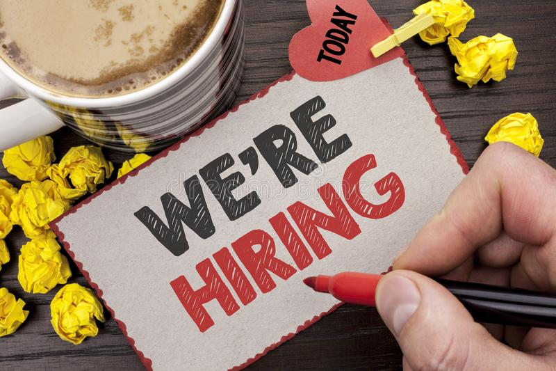 Writing note showing Were Hiring. Business photo showcasing Recruiting Hiring Now Recruitment Vacancy Announced Hire written Ma. N Holding Marker Cardboard royalty free stock photography
