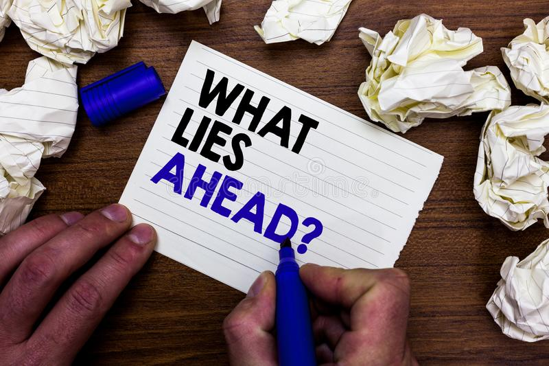 Writing note showing What Lies Ahead question. Business photo showcasing Asking for information about something on the way Hand ho stock photo
