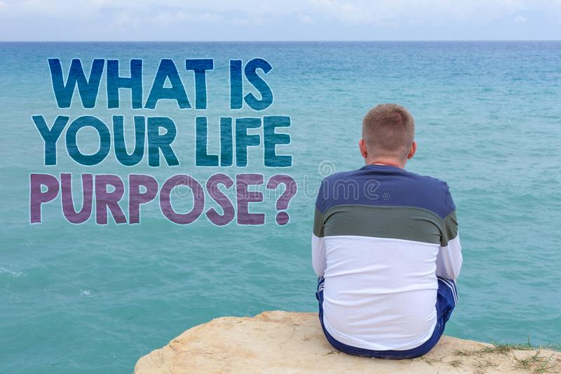Writing note showing What Is Your Life Purpose Question. Business photo showcasing Personal Determination Aims Achieve Goal Man s. Itting sand watching beach stock images
