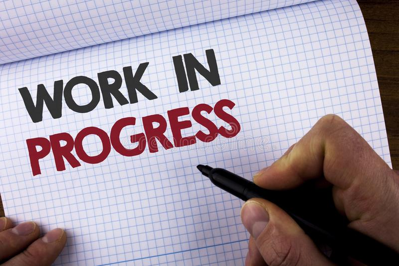 Writing note showing Work In Progress. Business photo showcasing People is working right know to deliver expected results written. By Man on Notebook Book stock photography