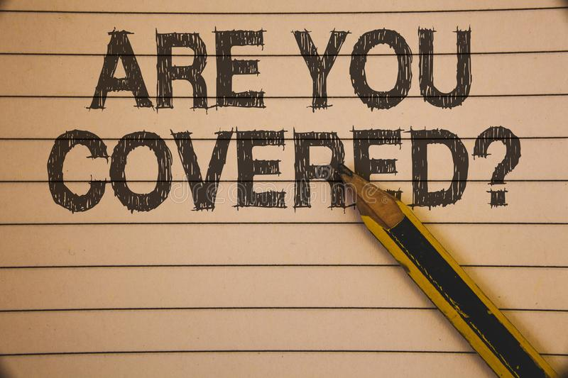 Writing note showing Are You Covered Question. Business photo showcasing Have a Security and Health Insurance Medical Care Ideas. Concepts on old beige notebook royalty free stock image