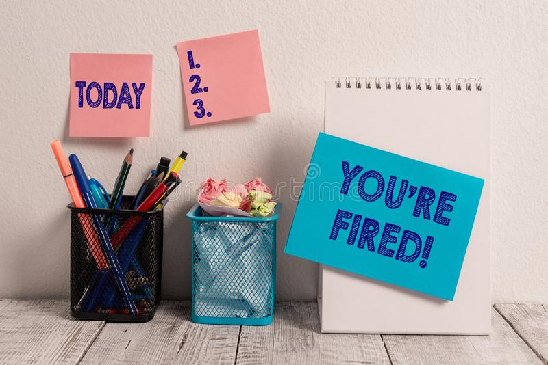 Writing note showing You Re Fired. Business photo showcasing Used by boss indicate employee that he is discharged from stock image