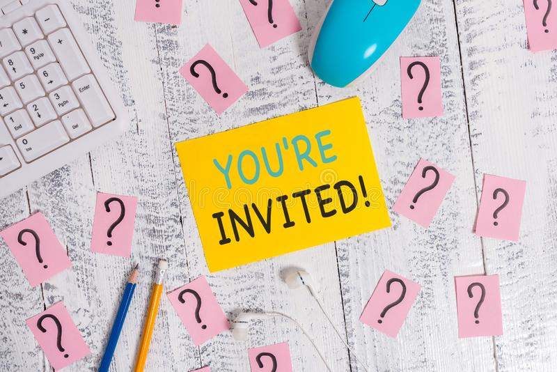 Writing note showing You Re Invited. Business photo showcasing make a polite friendly request to someone go somewhere. Writing note showing You Re Invited royalty free stock images
