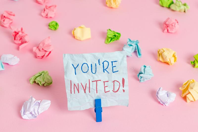 Writing note showing You Re Invited. Business photo showcasing make a polite friendly request to someone go somewhere. Writing note showing You Re Invited stock photo