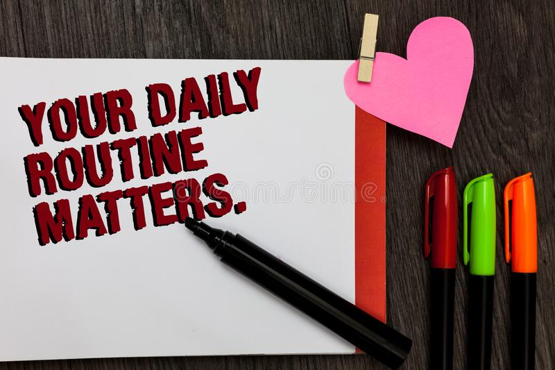Writing note showing Your Daily Routine Matters. Business photo showcasing Have good habits to live a healthy life Bold. Red words pen on page small heart stock image